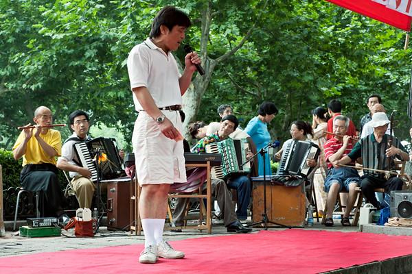 10)Man Singing on Stage