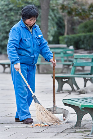 2) Woman Sweeping In Park