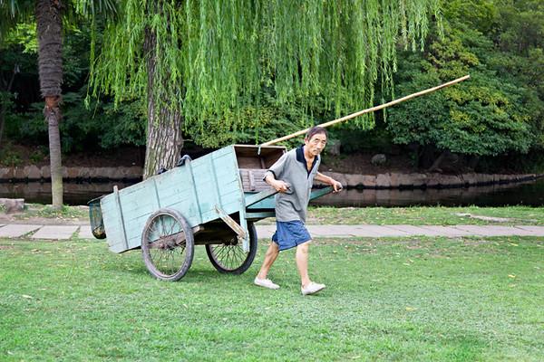8) Man Pulling Cart