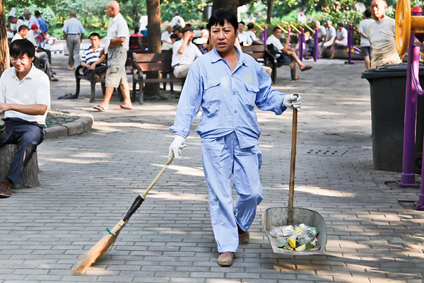 4) Woman With Broom