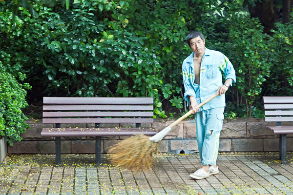 7) Man Sweeping the Leaves