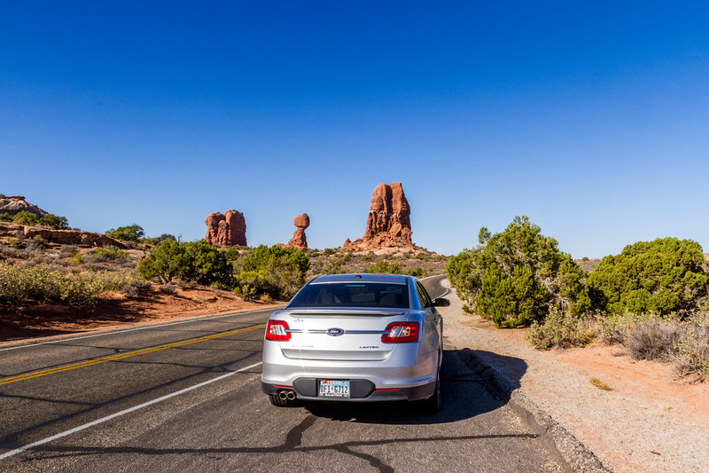 Ford Taurus on park road near Balanced Rock in Arches National Park.