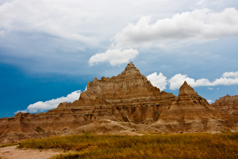 Storm Clouds at the Badlands National Park in South Dakota. Authorized as Badlands National Monument on March 4, 1929, President Franklin Roosevelt issued a proclamation on January 25, 1939 that established Badlands National Monument. In the late 60's, Congress passed legislation adding more than 130,000 acres of Oglala Sioux tribal land, used since World War II as a U.S. Air Force bombing and gunnery range, to the Badlands to be managed by the National Pakr Service. An agreement between the Oglala Sioux Tribe and the National Park Service governing the management of these lands was signed in 1976. The new Stronghold and Palmer Creek units added lands having significant scenic, scientific and cultural resources. Congress again focused it's attention on the Badlands in 1978 on 10 November, it was redesignated as Badlands National Park. Badlands National Park contains the world's richest Oligocene epoch fossil beds, dating 23 to 35 million years old. The evolution of mammal species such as the horse, sheep, rhinoceros and pig can be studied in the Badlands formations.  This park also contains and shares National Grasslands areas.