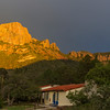 Sunset golden light on Casa Grande Mountain in the Chisos Mountains in Big Bend National Park.