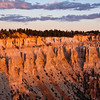 """Sunrise at Bryce Point in Bryce Canyon National Park in Utah. One of the best viewpoints of the """"silent city"""" of hoodoos, Bryce Point is a good site for both sunrise, with beautiful aplenglow, and sunset shadows and contours."""