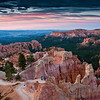 Pre-dawn light, just before sunrise, at Sunrise Point in Bryce Canyon National Park in Utah. The hoodoos and rock formations are bathed in a soft light with pink and bluish tones that will turn orange with the first light after sunrise. This viewpoint is the most photographed sunrise viewpoint in the park.