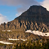 """Reynolds Mountain in Glacier National Park in Montana. Reynolds Mountain is a true """"horn"""" mountain, carved by multiple glaciers on all sides, shaping it in a pyramid form."""
