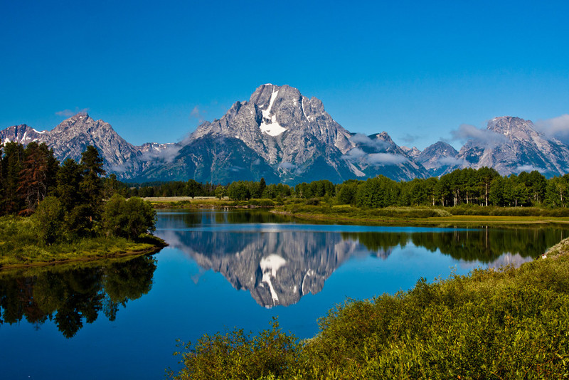 Reflections of the Grand Tetons and Mount Moran in the Snake River at Oxbow Bend, in the Grand Tetons National Park in Wyoming. This is probably the most photographed and the most convenient view of the Mount Moran and the Grand Tetons mountain range.