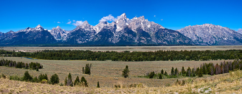 Panorama of Grand Tetons Mountain Range in the Grand Tetons National Park in Wyoming.