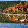 Fall colors are reflected in a lake in Acadia National Park.