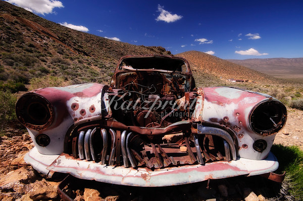 An old car is decaying on a hillside near the Aguereberry mine and homestead in Death Valley National Park.