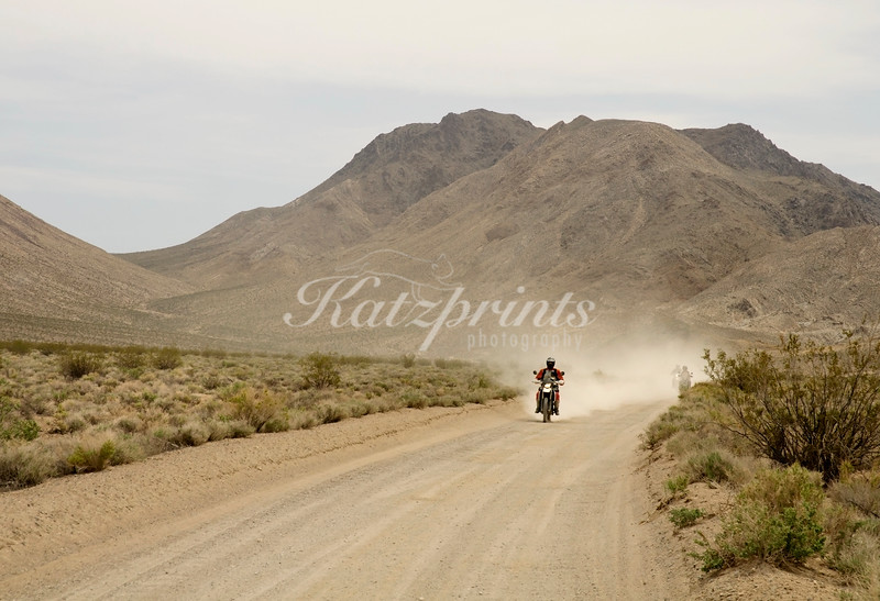 A group of motorcyclists is enjoying a ride on one of Death Valley's many unpaved roads.