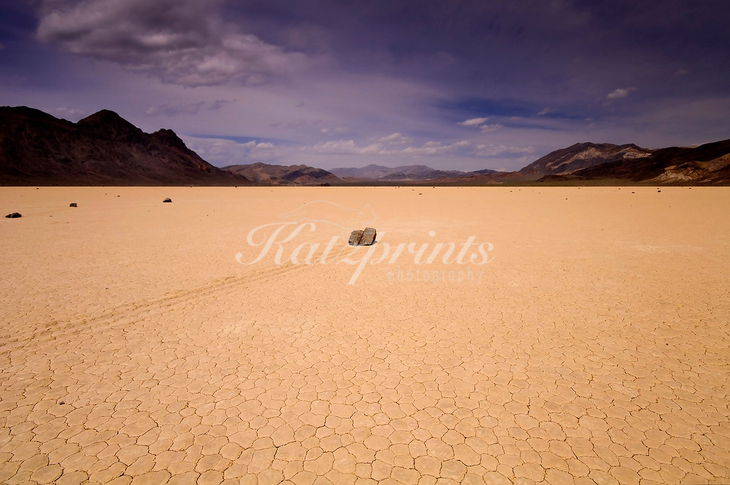 This is a shot I took at Racetrack Playa, a dry lake in Death Valley NP. It is famous for its wandering or sailing stones, an interesting geological phenomenon! The stones move without human intervention (at least the genuine ones do...) and leave tracks behind them in the cracked mud.