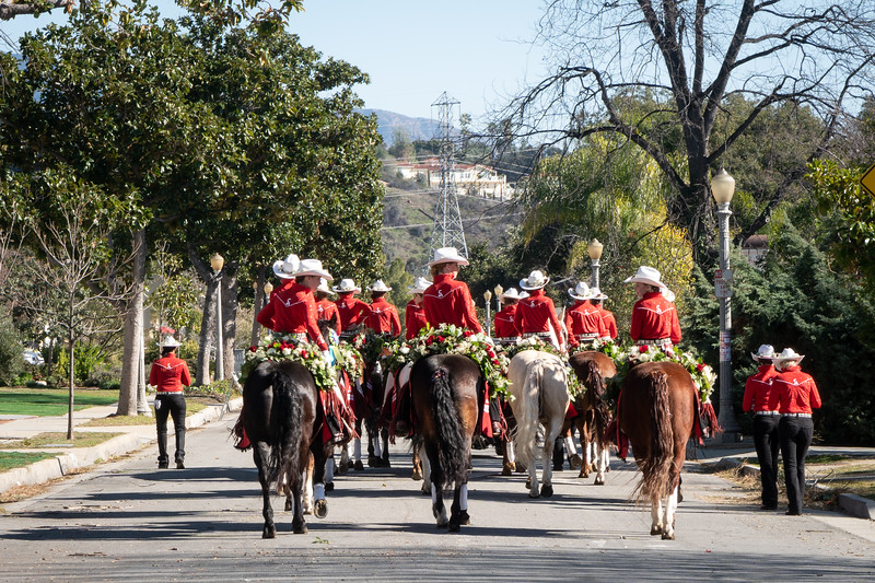 The Calgary Stampede Showriders make their way through the streets of Pasadena after the Rose Parade