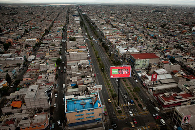 Mexico city, as seen from the air on election day, July 1, 2012. In the foreground can be seen a billboard advertising the candidacy of Enrique Pe–a Nieto, the eventual winner of Mexico's presidency.