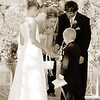 Outdoor wedding ring exchange in sepia