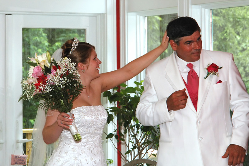Bride fixing her daddy's hair before the ceremony.
