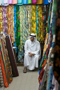 Fabric vendor in Souq Wakif.