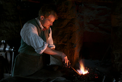 Frontier Culture Museum's 18th century Irish forge glows with blacksmith's iron work.