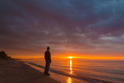 man on beach in sunrise