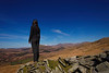 Girl standing on dry stone wall