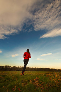 Young woman jogging in a field