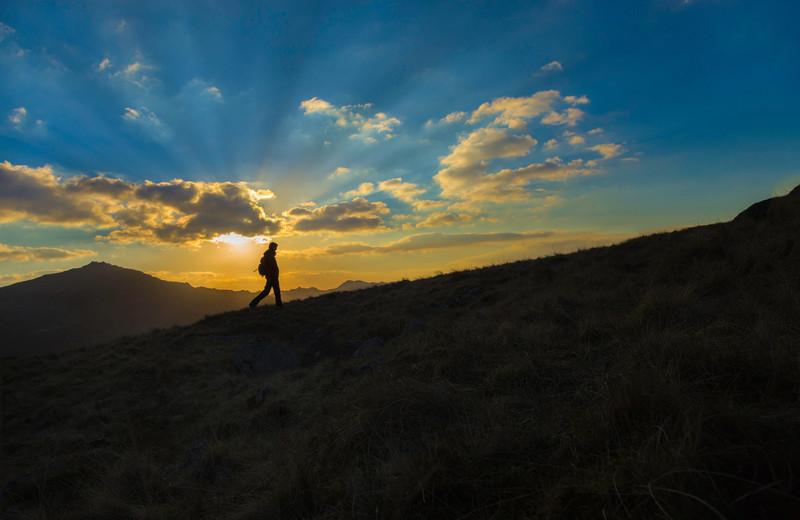 Mountain hiker sunburst