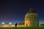 Tourist looking at Pisa Baptistery