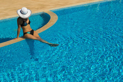 Pool girl in white hat