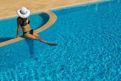 Pool girl in white hat
