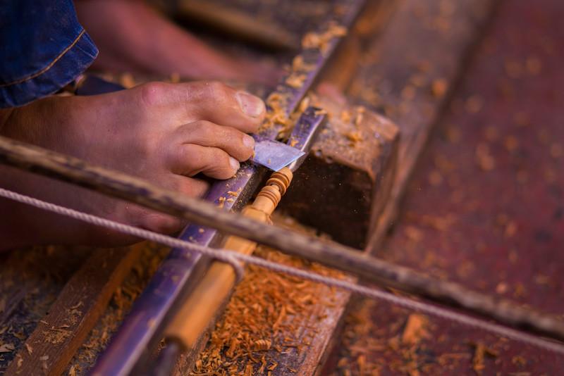 Moroccan carpenter using his feet.