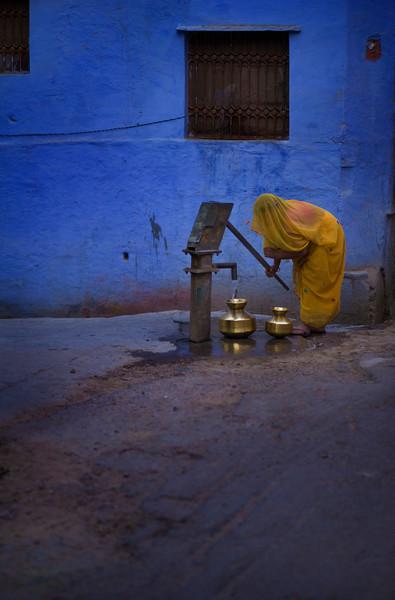 Woman pumping water