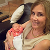 Aunt Sandie holds her niece for the first time.