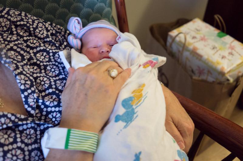 Grandma Henriette holds her granddaughter.