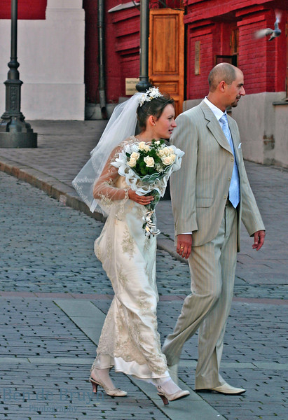Moscow People: Married couple walking at Manezhnaya Square