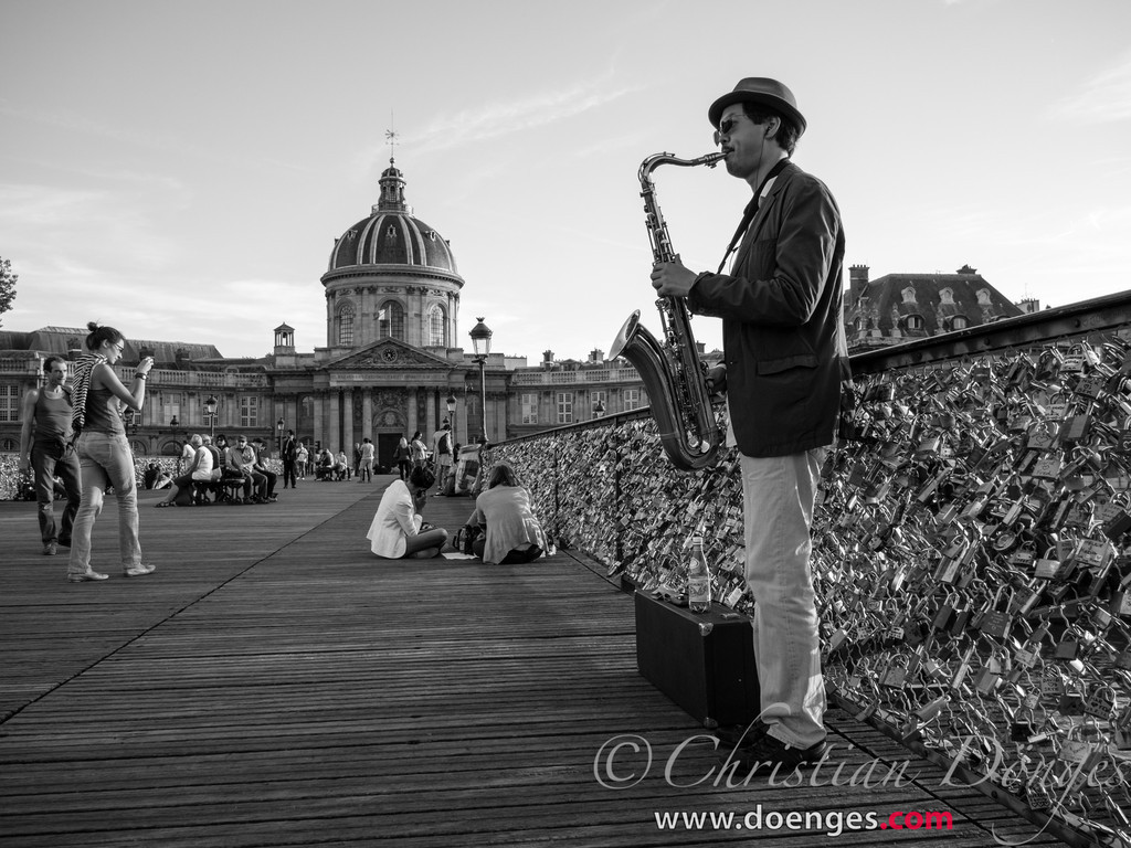 Stephen plays the Saxophone on the Pont des Arts in Paris.