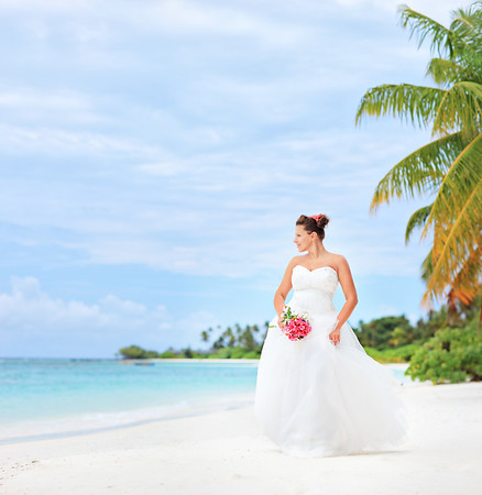 A bride on a beach in Kuredu resort, Maldives island