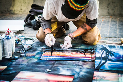 """""""Boardwalk Painter""""  A spray paint artist creates a magical and mystical painting on the boardwalk, In Pacific Beach, San Diego, California."""