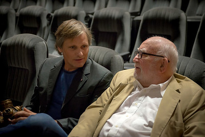 """Viggo And Ed""  Viggo Mortensen and Ed Asner share a private moment at the 2013 AMFM Festival in Cathedral City, California."