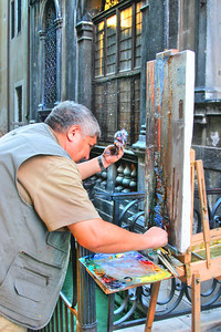 Fellow artist painting one of the many canals in Venice Italy.