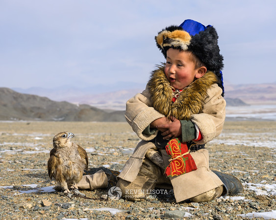 Kazakh boy and his Saker falcon in Mongolia