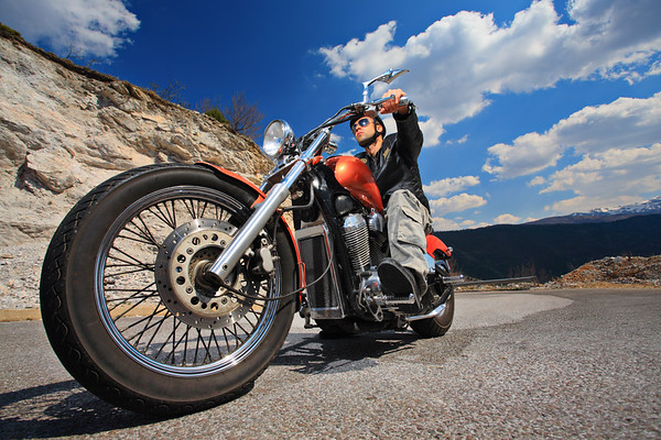 Biker cruising on an open road