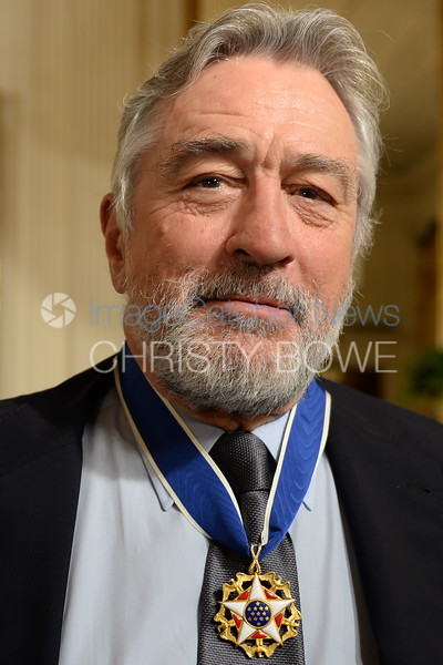 Actor Robert De Niro awaits her turn to receive the Presidential Medal of Freedom in a ceremony in the East Room.