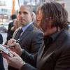 Johnny depp autographs a DVD