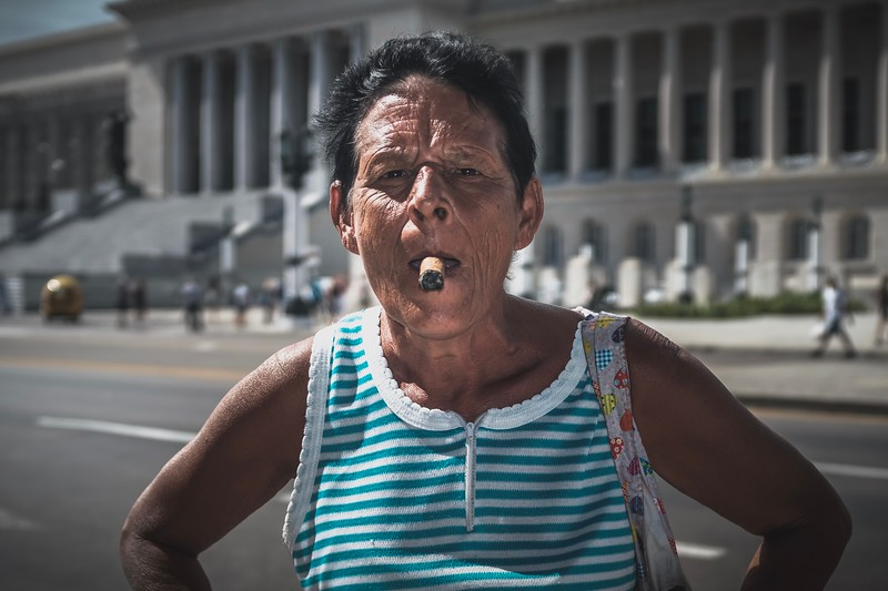 A Cuban woman shows her cigar smoking skills in Havana.