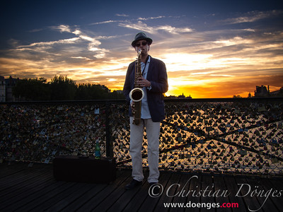 Stephen plays the Saxophone into the sunset on the Pont des Arts in Paris.