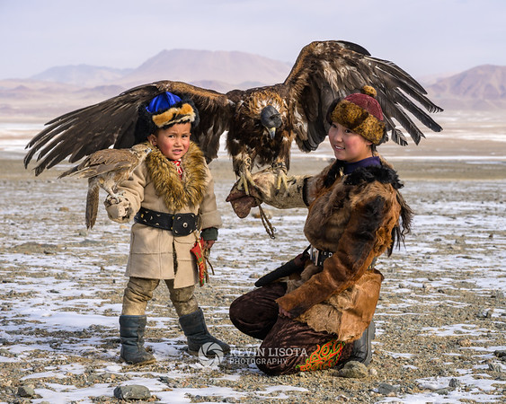 Kazakh boy and girl with their falcon & eagle