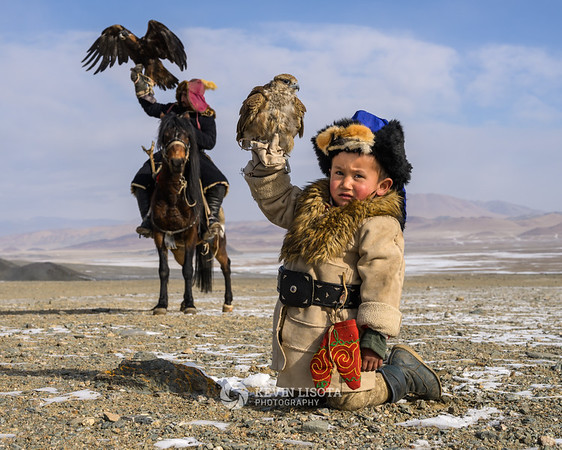 Two generations of Kazakh eagle hunters.