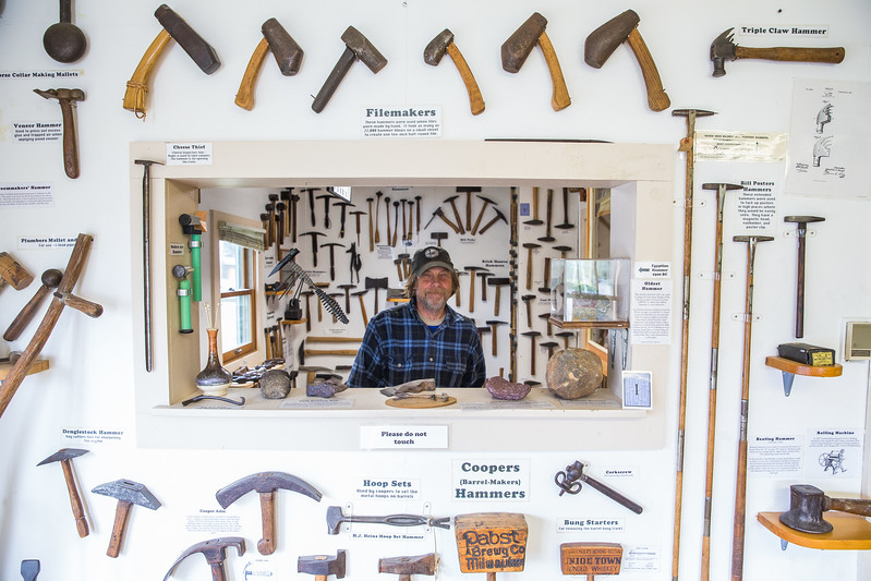 Caption SB071917A: Dave Pahl, the found of the Hammer Museum, poses for a portrait in his collection of hammers.