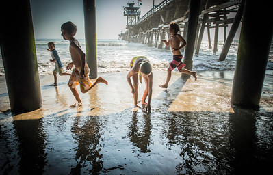 Kids at play under the San Clemente pier.